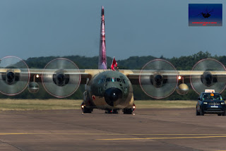 Royal Jordanian Airforce C-130H Taxiing behind Land Rover Discovery.