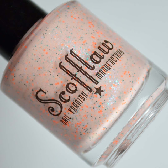 orange peach nail polish with aqua shimmer