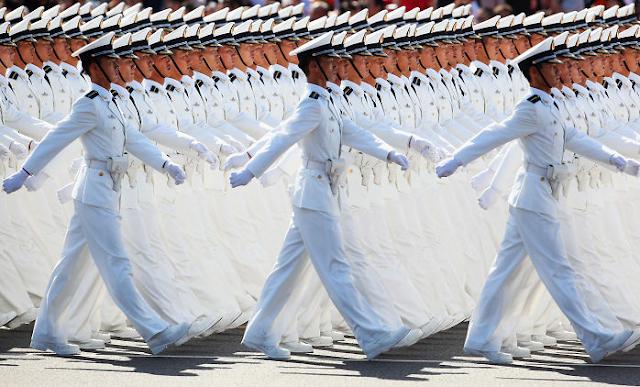 Bu Çinlilerin disiplinine hayranım