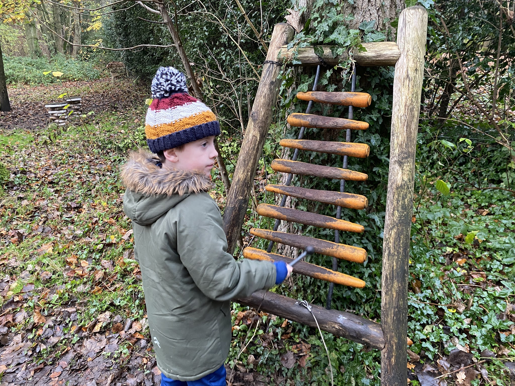 boy playing woodland instruments
