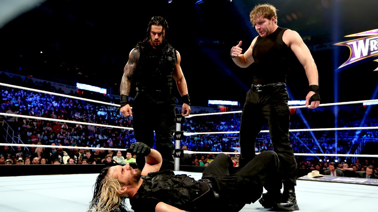 Just some brothers scrappin', that's all. Photo Credit: WWE.com