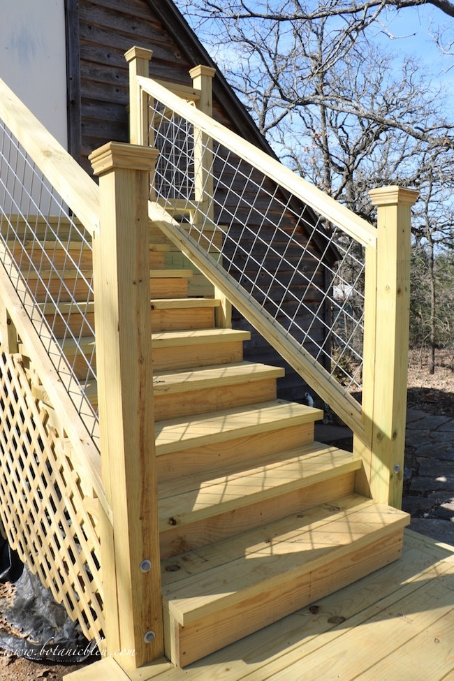 3 design factors for exterior wood stairs included using wood post caps to prevent post rot from rain