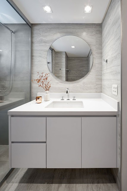Bathroom cabinet with tub and round mirror
