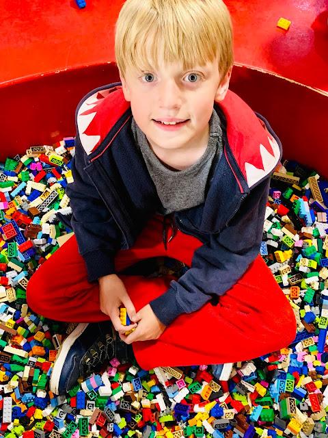 boy sitting in Lego