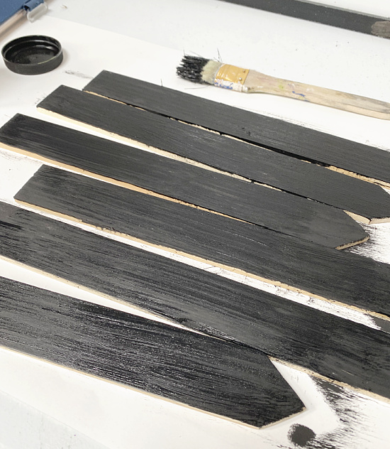 black painted wooden stakes
