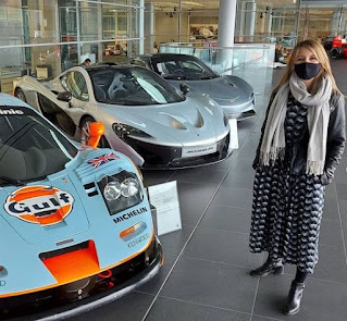 Wendy Hurrell clicking picture with classic car