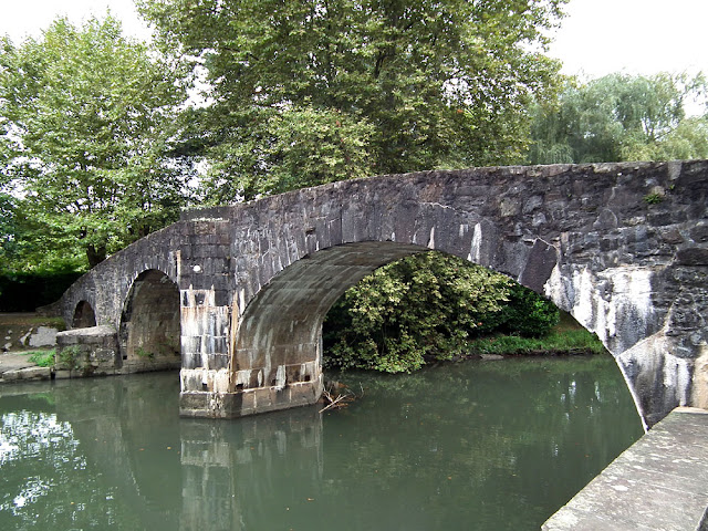 Roman bridge over the Nivelle at Ascain. Pyrenees-Atlantiques. France. Photographed by Susan Walter. Tour the Loire Valley with a classic car and a private guide.