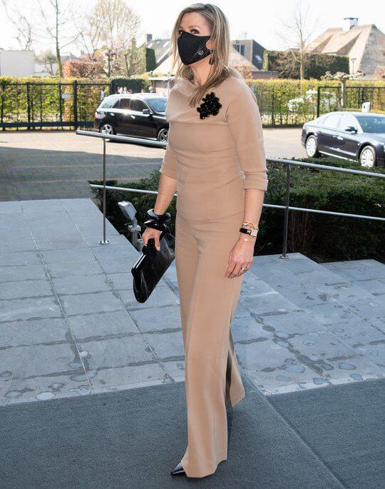 Queen Maxima wore beige top and beige trousers from Natan. Maison van Belle black earrings. Natan black brooch