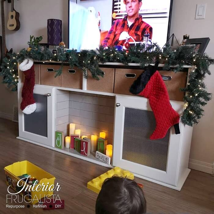 DIY Faux Fireplace With Hidden Toy Storage Decorated For Holidays
