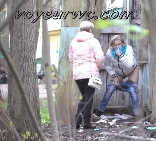 PissWC 269 (Girls peeing outdoors unsuspecting of a voyeur with a spy cam)