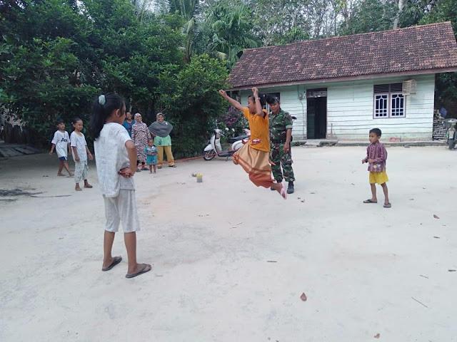 Dandim 0415 Ajak Warga Desa Ladang Peris Gelorakan Permainan Tradisional