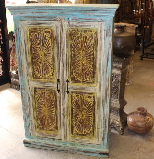 https://www.mogulinterior.com/indian-antique-cabinet-chakra-carving-rustic-chest.html