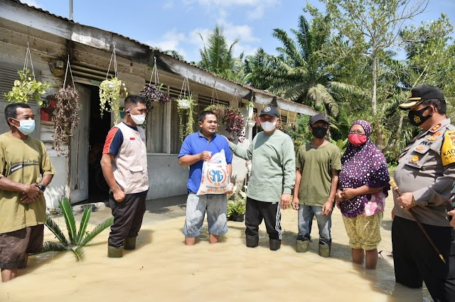 Bupati Batu Bara Tinjau Lokasi Banjir Yang Merendam Tiga Kecamatan