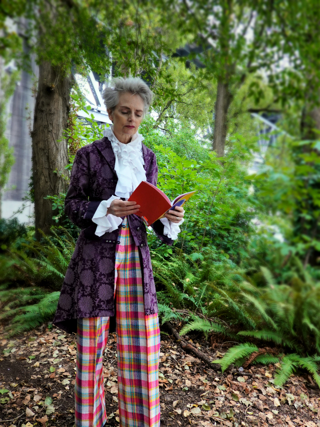 Mel Kobayashi, Bag and a Beret, frock coat, plaid pants, ruffled blouse, poetry