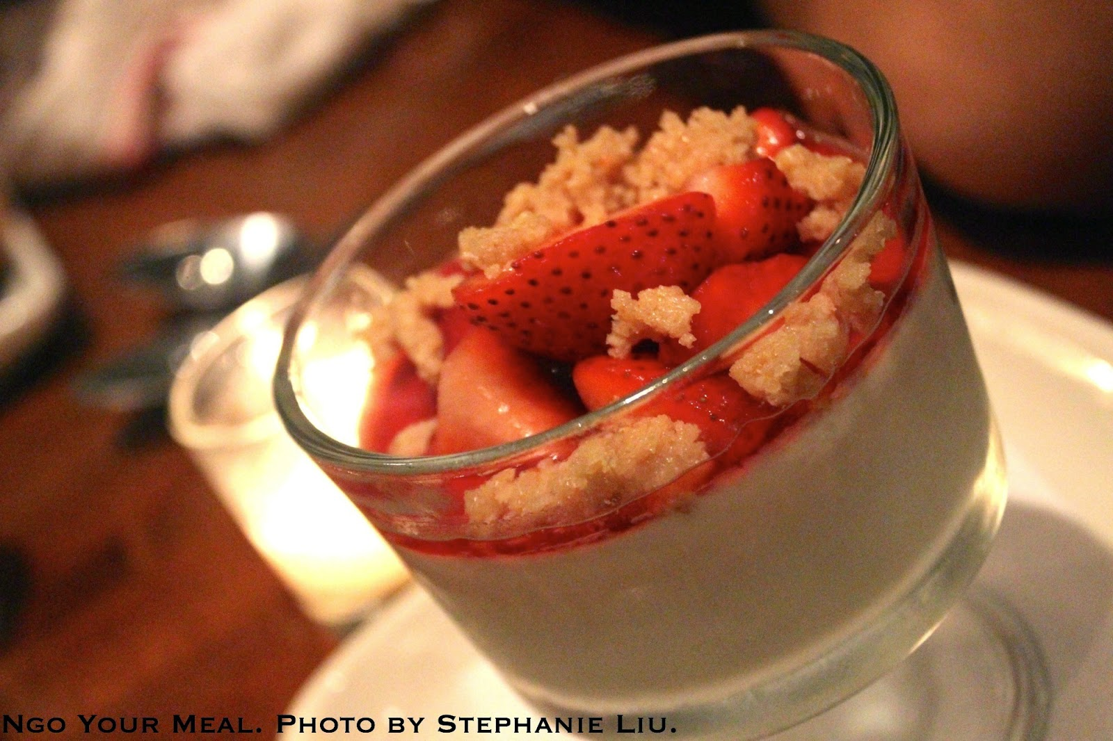 Honey Panna Cotta: greek yogurt, strawberry consommé, red berries, and sea salt brittle at Jane