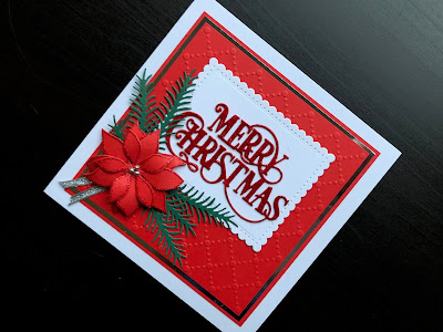 Hand made card with die cut poinsettia and Merry Christmas heat embossed with Red Glitz embossing powder