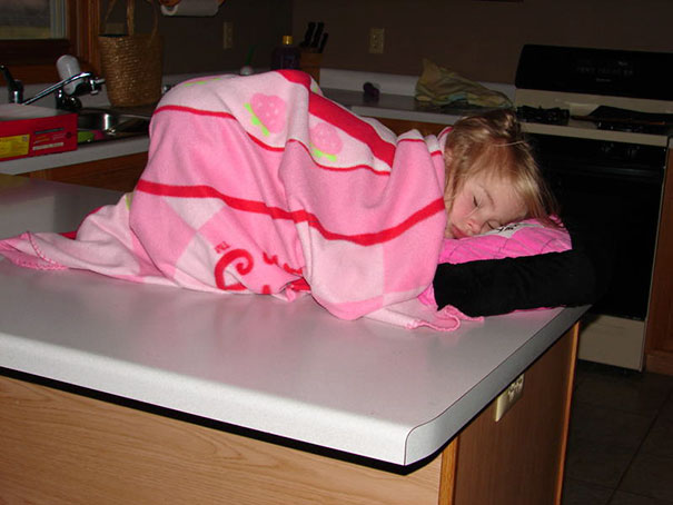 15+ Hilarious Pics That Prove Kids Can Sleep Anywhere - Napping On A Kitchen's Counter