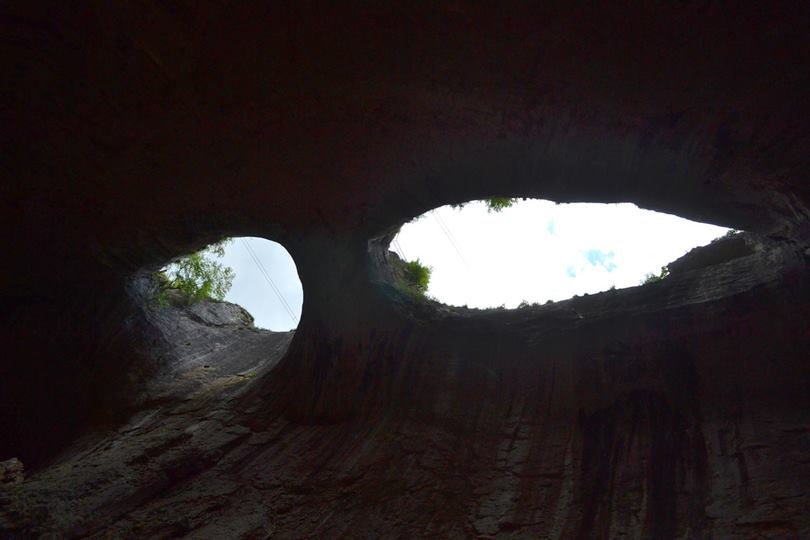 Prohodna is a karst cave Bulgaria, located in the Iskar Gorge near the village of Karlukovo in Lukovit Municipality, Lovech Province. The cave is known for the two eye-like holes in its ceiling, known as the Eyes of God or Oknata.