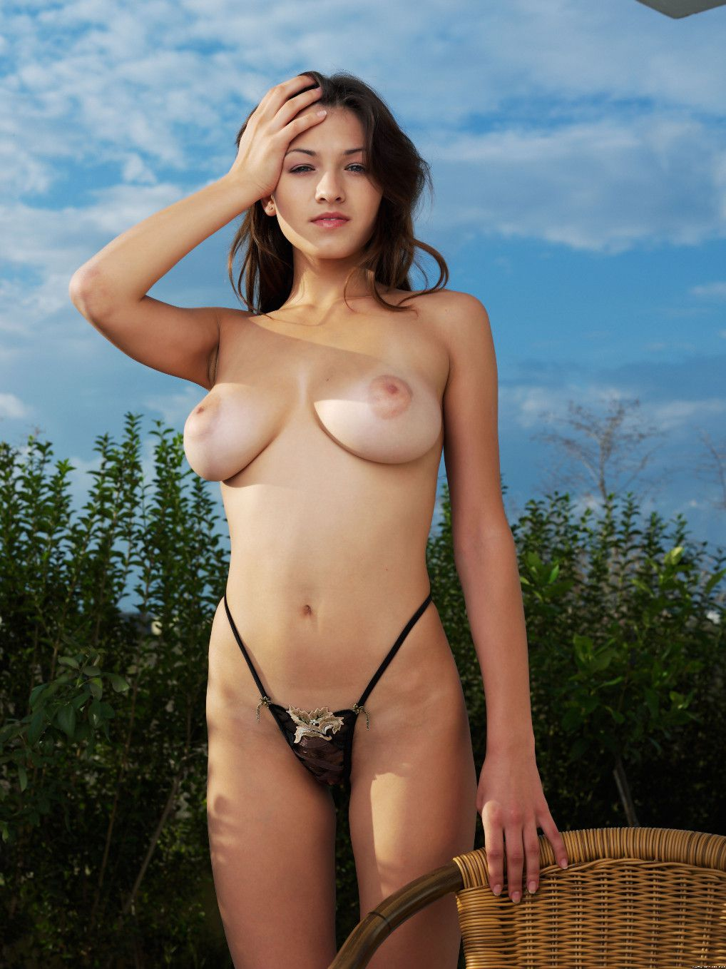 posing nude outside