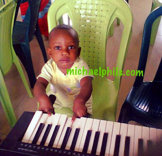 child playing the chromatic scale on the piano