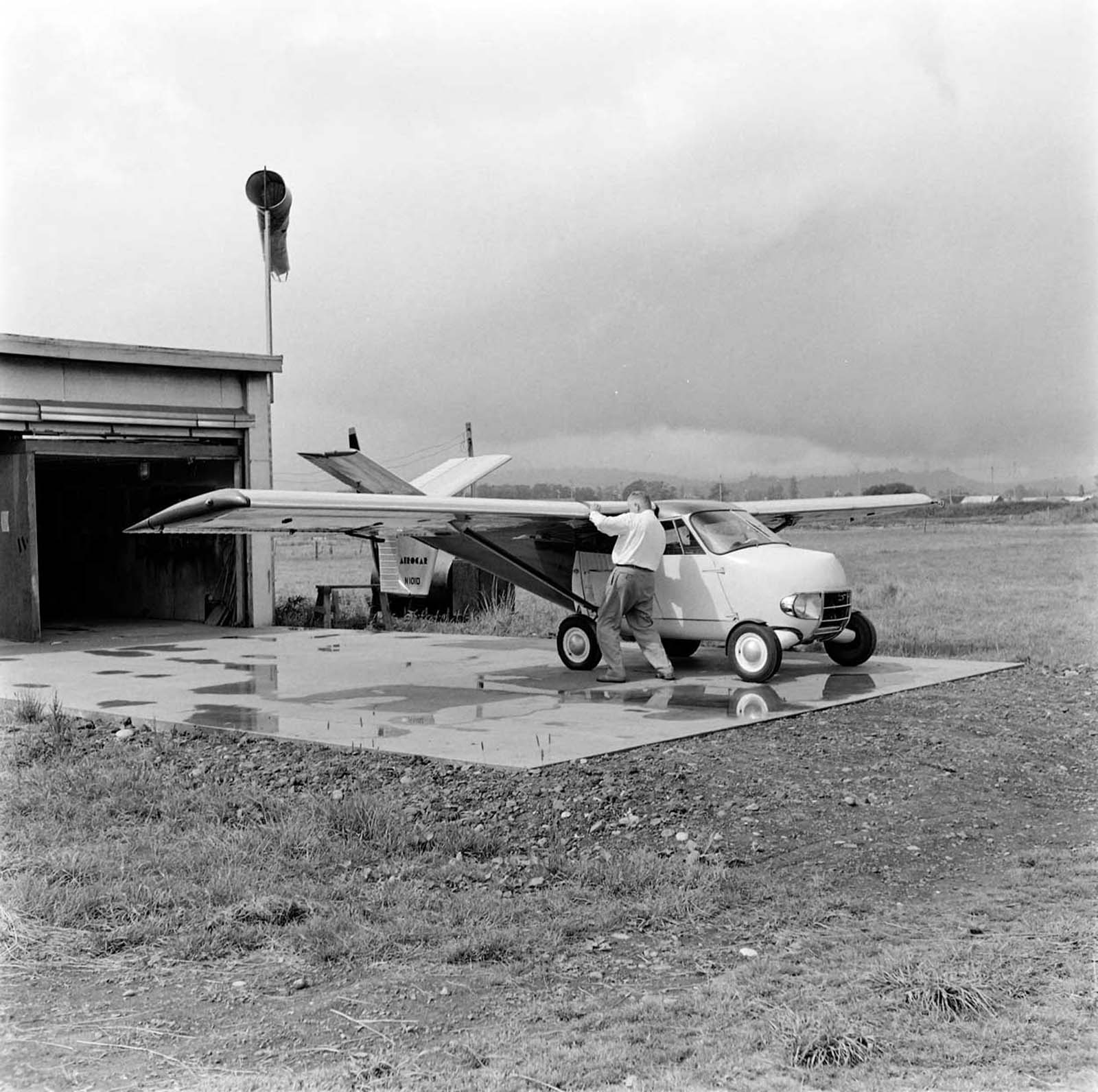 Moulton Taylor's Aerocar. The aerodynamic elements had convenient stowaway wheels that formed their own trailer for road-going travel. 1957.