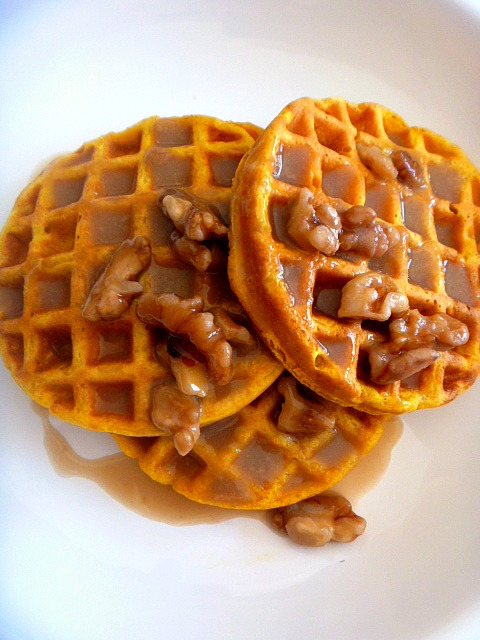 Pumpkin Waffles with Maple Walnut Cream Syrup:  With an easy to make batter these toasty and fluffy waffles, bursting with warm spices and pumpkin flavors, will be on your table in no time. - Make Ahead for Thanksgiving morning! - Slice of Southern
