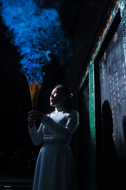 Hire a photographer in Saigon - Lady with incense in Saigon