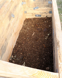 Starting to fill up the raised bed