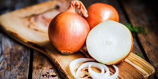 Onions water as one of the natural ways to boost hair growth.