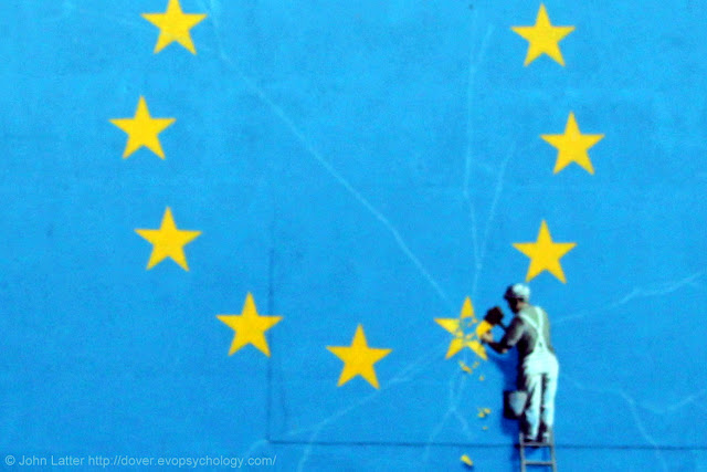 Close-up of the Banksy Brexit mural showing cracks emanating from the star being removed, symbolizing that cracks will remain within the European Union, even after the United Kingdom has gone. 1826 Georgian former King's Arms Library building.