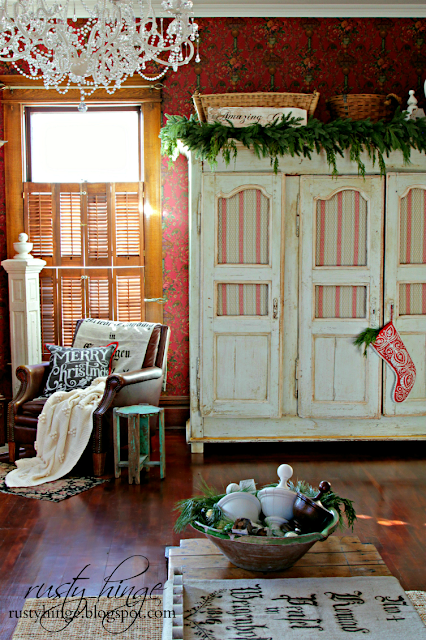 Rusty Hinge Christmas living room with antique French linen armoire