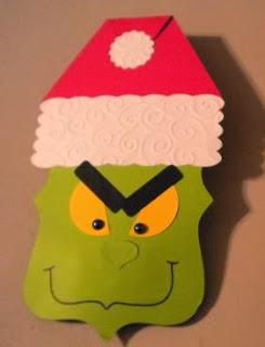 http://lasmanualidades.imujer.com/5535/grinch-navideno-de-cartulina-para-guardar-dulces