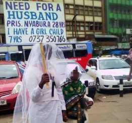 Photo: Kenyan single mum carries a banner on the street as she begins her search for a husband