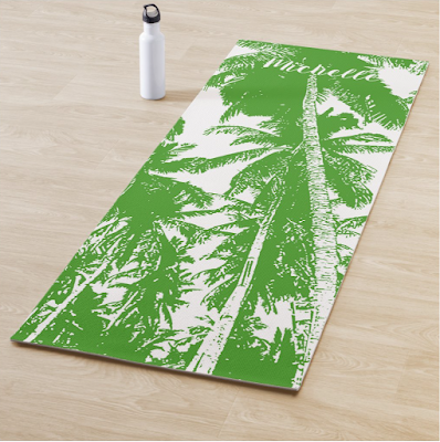 Palm trees posterised effect on a yoga mat. Green and white. Personalised with the owner's name.