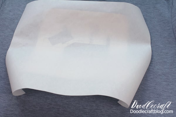 Warm up the shirt with the EasyPress 2. Then place the Infusible Ink Transfer ink side down on the shirt. Then cover it with the included butcher paper.