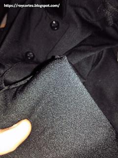 99 pesos dri fit polo shirt close up