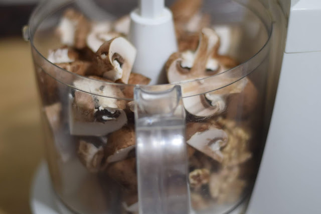 The walnuts and mushrooms in a food processor.
