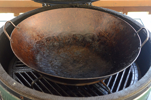 One wok setup for a Big Green Egg kamado grill.