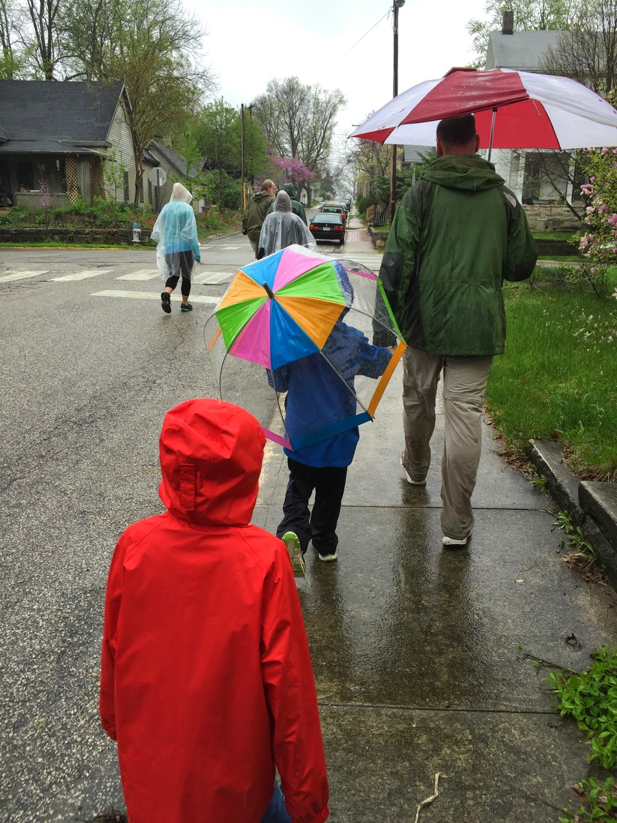 Chris and the boys following the other walk participants in the rain.