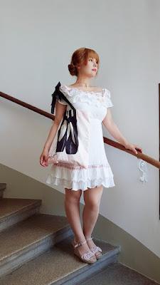 auris wearing a swankiss dress and a rosemarie seoir bag