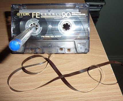... de enrolar a fita da k7 audio