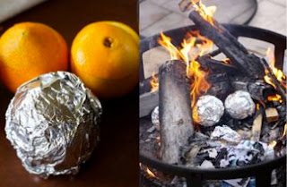 Egg and batter in Orange cooking  on campfire- breakfast in an orange.