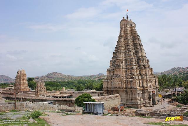 A view of Virupaksha temple tower and complex from Hemakuta Hill in Hampi, Karnataka, India