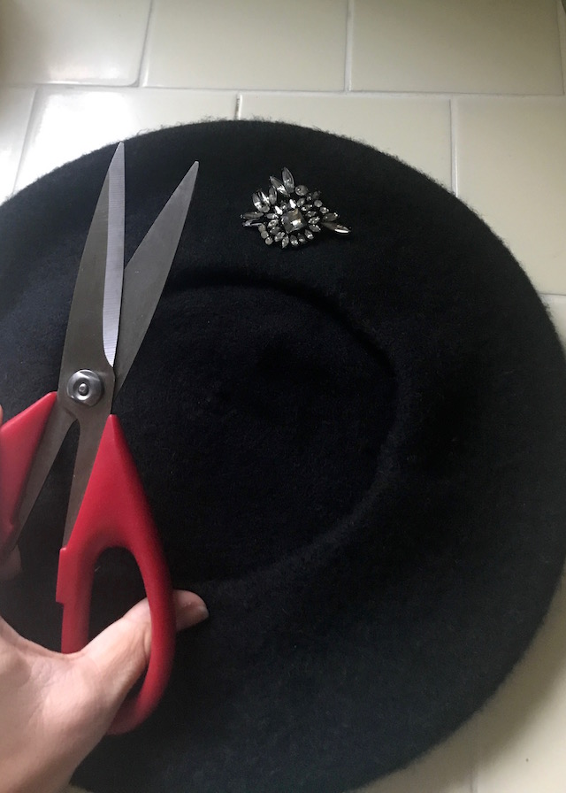 Beret with old brooch and scissors