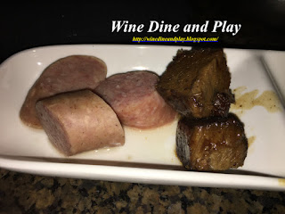 Some German bratwurst sausage and beef sauerbraten dippers to go with the Oktoberfest fondue at the Melting Pot restaurant in St. Petersburg, Florida.