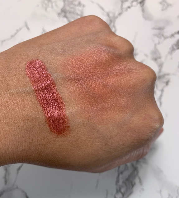 NARS Powder Blush Dominate swatch on dark skin