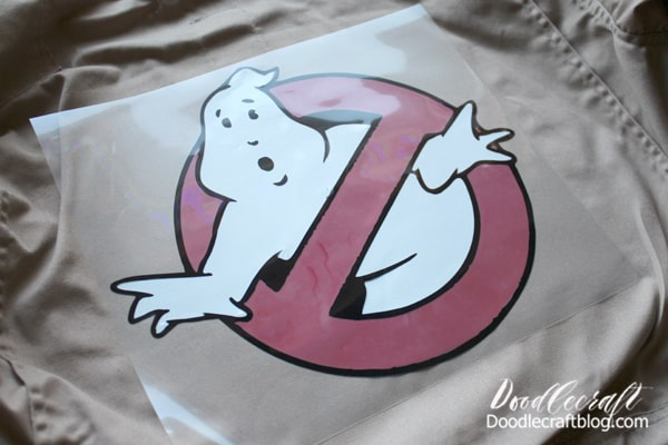 Ghostbusters logo pressed onto tan jumpsuit for the perfect Halloween costume or cosplay using the cricut maker explore air 2 or other electronic cutting machine and the Easypress.