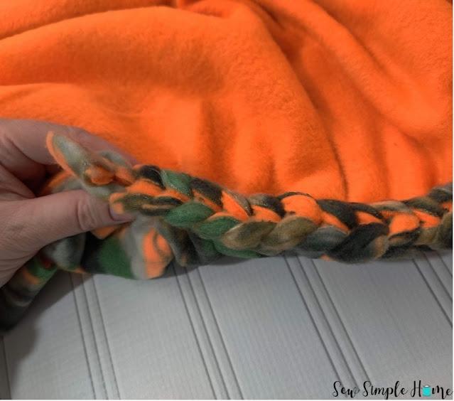 braided edge fleece blanket
