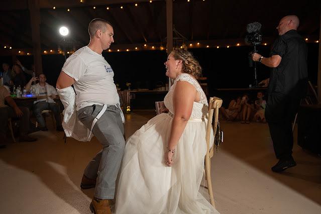 Garter toss Groom dance Magnolia Manor Wedding Photos by Stuart Wedding Photographer Heather Houghton Photography