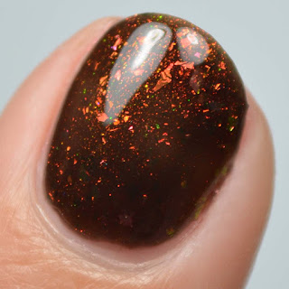 black jelly nail polish with color shifting flakies